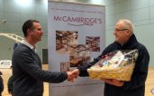 Loyal Supporters: Andy Barber collects his McCambridges Hamper from Luke Anthony of MCCambridges