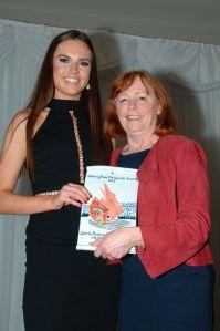Judy Greene presents Catherine with the Basketball award