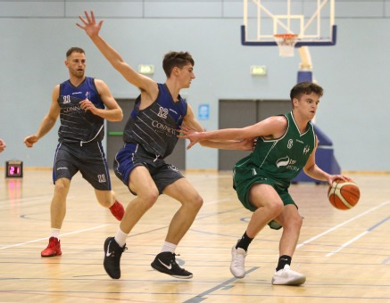 Moycullen v Maree Super League Basketball game at the Kingfisher, NUI Galway. Moycullen's Paul Kelly, and Maree's Enda Walsh (11) and John Burke (12).