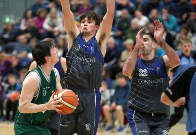Moycullen v Maree Super League Basketball game at the Kingfisher, NUI Galway. Moycullen's Cian Nihill and Maree's Eoin Rockall and Paul Freeman