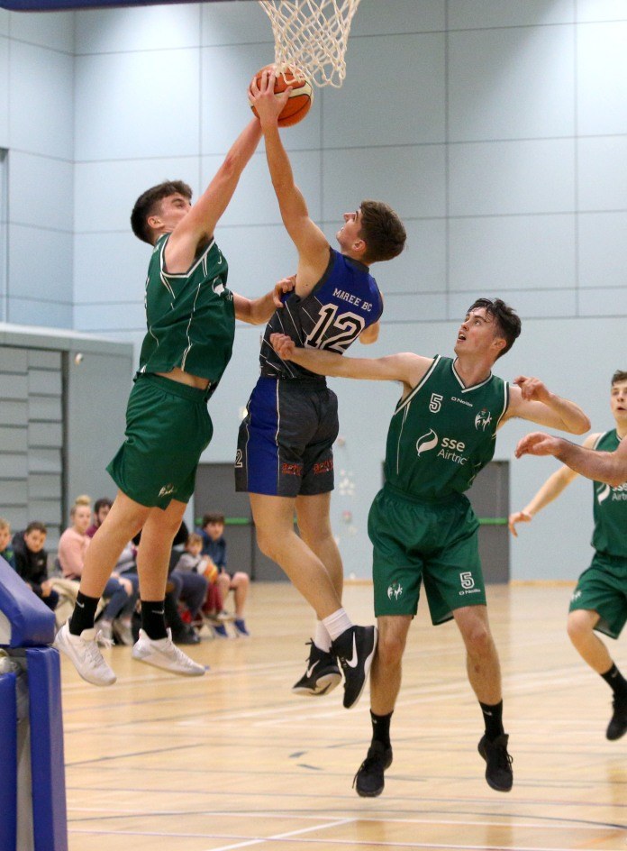 Moycullen v Maree Super League Basketball game at the Kingfisher, NUI Galway. Moycullen's Paul Kelly and James Lyons, and Maree's 12