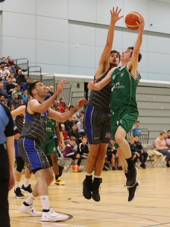 Moycullen's Cian Nihill gets his lay-up away despite the close attentions of Maree's Paul Freeman and Niels Bunschoten.
